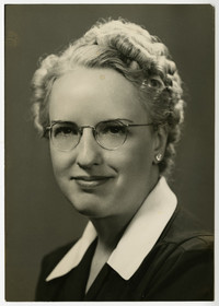 Studio portrait of unidentified young woman in spectacles and blonde curls