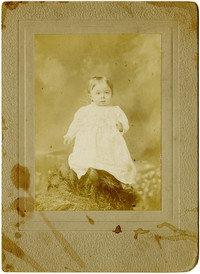 Studio portrait of small child in christening gown