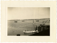 Northwest Cannery and Naknek - Several small sailing vessels and barges in water