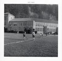 1965 Girls Playing Field Hockey