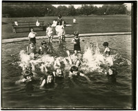 A group of children splash in a wading pool at Fairhaven Park, Bellingham, WA.
