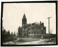 Previous Whatcom County Courthouse, a multi-story sandstone building with tower and gables
