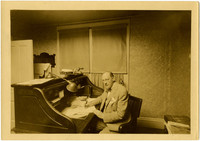 Roland Gamwell seated at desk