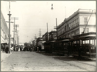 Unidentified street scene - probably Bellingham - with large crowd of men, women and children in the middle ground