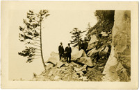 Chuckanut Drive construction - five men in suits stand on rocky ledge