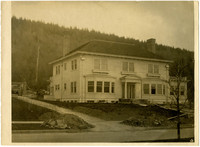 View from across street of large, stately home of Barlett T. Helen Drake at 115 South Forest Street, Bellingham, WA, nearing constructing completion (home later occupied by Dr. Edward Stimpson and family)
