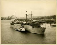 "A massive freight vessel the ""Neva"" and tug boat move through Lake Union"