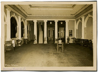 Lobby of American Theater with classical architectural elements, carpet, velvet drapes