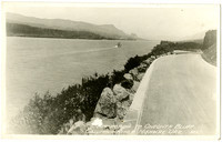 Highway curves around Oneota Bluff in view of Columbia River