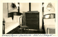 Quarters aboard ship Mary D with two beds, two portholes, a dresser