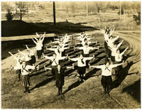 Twenty eight Fairhaven high shool students conduct exercises in four rows in physical education class outdoors