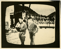 Blurry photograph taken of television screen playing movie