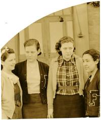 Four Fairhaven High School girlds stand outside school doors