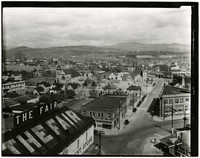 View from above of buildings along Champion Street, Bellingham, WA, with excavation site of Mt. Baker Theater in center of image