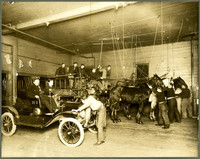 Early Bellingham fire house with a very early fire car and a three horse drawn fire truck/wagon.