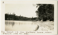 """Shoreline surrounded by trees with caption: """"In front of the Walters home, where Jimmie used to play."""""""