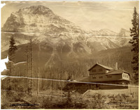 A Canadian Pacific Railway lodge stands on an alpine hillside at the base of Mount Stephen, in the background