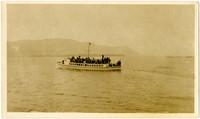 Ferry heavily laden with passengers travels across Bellingham Bay, WA