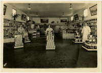 Interior of Durgin's market with three clerks