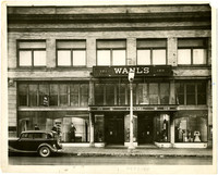 Exterior of Wahl's Department Store shows display windows with mannequins