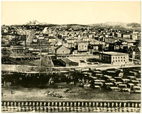 Drawing of seaside town, possibly Bellingham, WA, with piles of lumber on beach, horse-drawn wagons, and wooden boardwalks