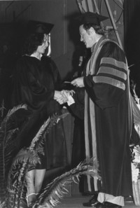 1981 President Olscamp With Student at Commencement