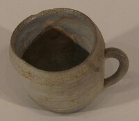 Cup with handle and slightly warped rim