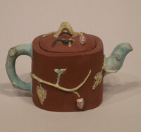 I-hsing ware teapot with enameled decoration