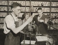 1950 Chemistry Laboratory: Two Students with Kermit Bengston