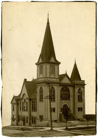 Unidentified church with tall steeple and gothic windows