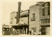 Several men constructing or repairing doorway of Paramount Theater, Anacortes, Washington