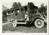 Wood-sided school bus with school children and bus driver Charles Bourn of the Glacier-to-Deming, WA, bus route