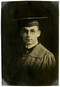 Unidentified young man in cap and gown studio portrait