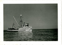 University of Washington Research purse seiner with load of netted salmon on deck