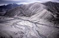 Channeled debris flow east of mountain.