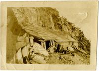 Primitive wooden structure on hillside