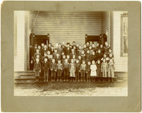 Gertrude Lillie Warpath with classmates and teachers poses on school steps