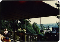 View from deck of home with seated woman