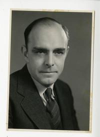 Studio portrait of S.R. Gilbert in suit and tie