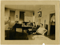 Interior of business office with five workers