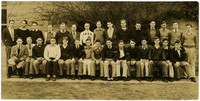 Fairhaven High School boys pose in two rows in front of school