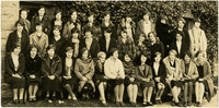 Group of young women pose in three rows in front of Old Main, Western Washington University