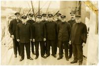 "Crew of steamer ""Windber"" pose in uniform on her deck"