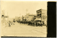 Easterly view of Holly Street at marching band and other processioners in parade