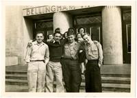 Four teenage boys pose on the steps of Bellingham High School