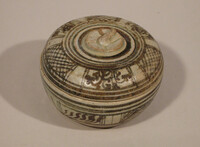 Sawankhalok ware lidded box with underglaze iron brown design of panels of hatching and floral scrolls on lid and base
