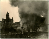 Unidentified building on fire, billowing smoke, with City Hall in background, Bellingham, WA