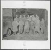 Eleven men and one woman, standing next to a Bornstein's Seafoods truck.