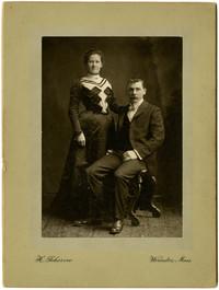 Studio portrait of unidentified couple