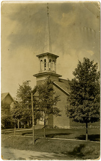 Postcard image of church with steeple and trees in front